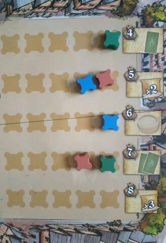 Le plateau de Renommée avec le coût et les bonus octroyés. Chaque joueur ne peut y poser qu'un seul pion par ligne.