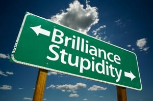 """""""Brilliance, Stupidity"""" Road Sign with dramatic clouds and sky."""