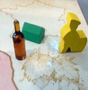 Les pions dans la version finale, les bouteilles ne ressemblent plus a des bouteilles de Porto.